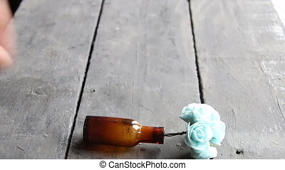 flowers in a bottle on old vintage table