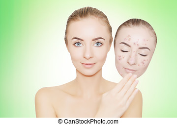 woman takes away mask with acne and pimples,green background