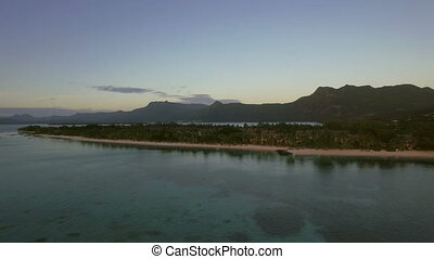 Mauritius aerial view with ocean and mountain ranges -...