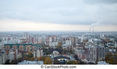 Russian industrial district - aerial panorama of autumn city in cloudy sky