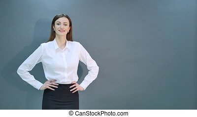 Awesome caucasian attractive joyful happy sexy dance model is jumping in studio wearing suit and shoes isolated on gray background