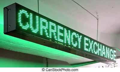 green currency exchange rate for dollar and euro on led display, numbers lighting