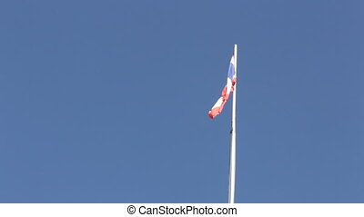 Thai flag of Thailand waving on blue sky