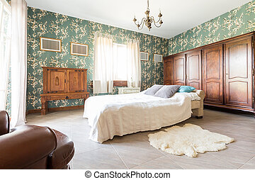 Bed in old-fashioned bedroom - Double bed and wooden...