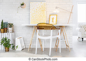 Minimalistic desk and chair in modernly designed room