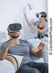 Couple using virtual reality goggles - Shot of a young...