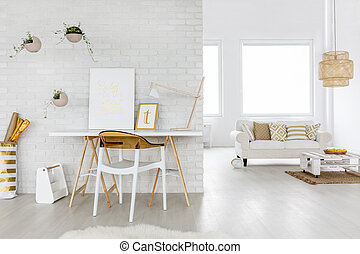 Spacious living room interior with couch and desk