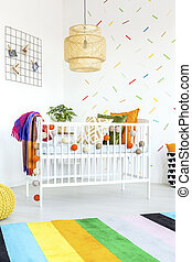White wooden cot in a baby bedroom