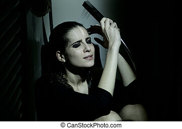 Sad depressed lonely scared woman crying under the shower -...