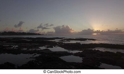 Black stones and coast in Mauritius at sunset, aerial view -...