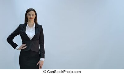 Happy young business woman isolated on gray background
