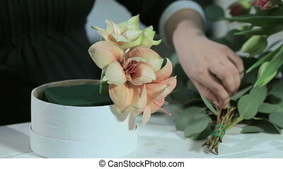 Florist cuts eucalyptus for flowers bouquets