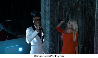 Duet African American man and a blonde woman singing HD