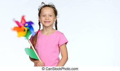 Child with colorful pinwheel toy - Happy little girl child...