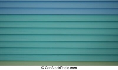 detail of blue closed jalousie at day. - detail of blue...