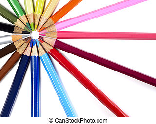Multi-colored pencils on white background
