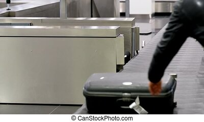 Luggage at carousel in the airport - Luggage on a conveyor...