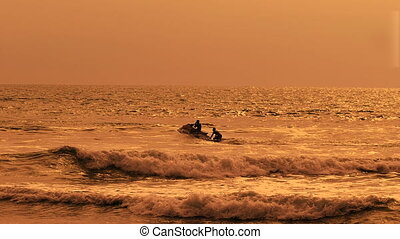 Bright view of wave runner cutting up the ocean with two men...