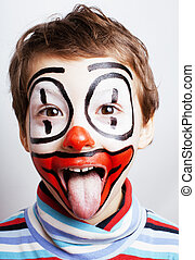 little cute real boy with facepaint like clown, pantomimic...
