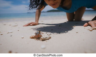 The island of Bali. Beach. Arthropods. Brunette on the...