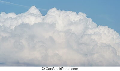 Towering cumulus clouds billows in summer sky time lapse