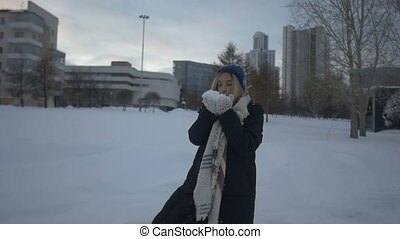 Beautiful girl playing with snow and fun.