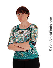 Serious woman standing waist up. - A middle age woman...