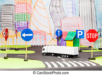 White truck cutting road in the toy city model - Picture of...