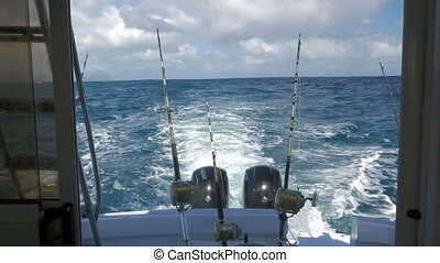 Yachts with fishing tackles sailing in ocean - View of the...