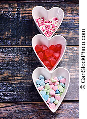 valentine wooden background with heart shaped bowls
