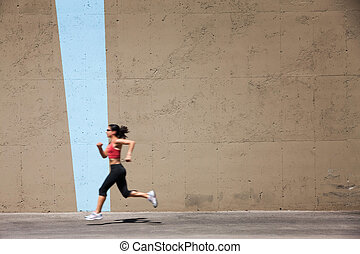 Incredibly fit woman out for a run, - Woman runs in...