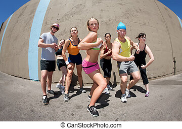 Woman posing with fellow athletes