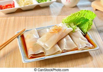 Fresh rolls of Pho with soyal sauce and green lettuce on...