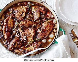 Stewed chicken in wine culinary poshag in restaurant
