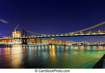 Panorama of Manhattan Bridge in New York City at night
