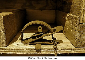Old gopher trap (sepia) - (sepia) A sprung gopher trap is...