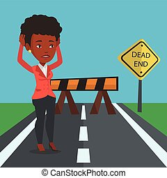 Business woman looking at road sign dead end. - An african...