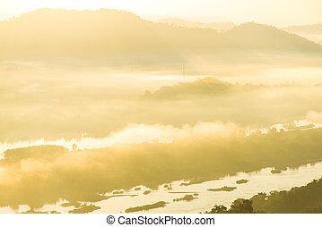 Gold foggy on sunrise background.