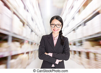Store manager in storehouse - Young Asian female store...
