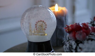 Christmas decorations. Shiny magical crystal ball. Snow...
