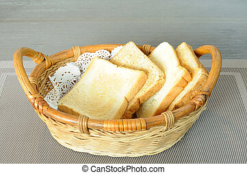 Rattan bread basket on gray napery