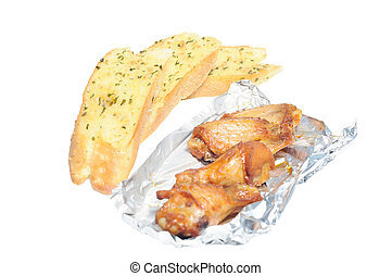 Garlic breads in row with Barbecue chicken wings in foil paper
