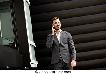 Young businessman outdoor - Young successful businessman...