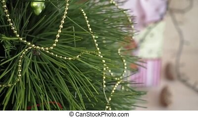Christmas Tree close-up slow rotated. Green Christmas tree...
