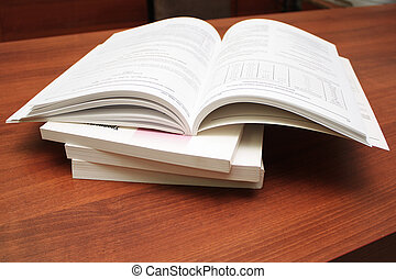 Catalogs. - A stack of catalogs on the table. Close-up.