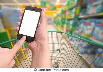 Woman hold and touch screen mobile phone while shopping in...