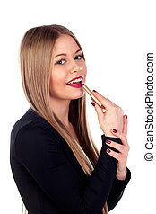 Fashion young woman painting her lips isolated on a white...