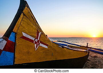 Pirogue at sunset - Traditional fishing pirogue at sunset in...