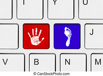 Printout of hand and foot on computer keys - Computer...