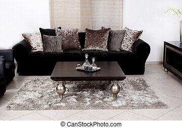 Modern black coloured fabric couch